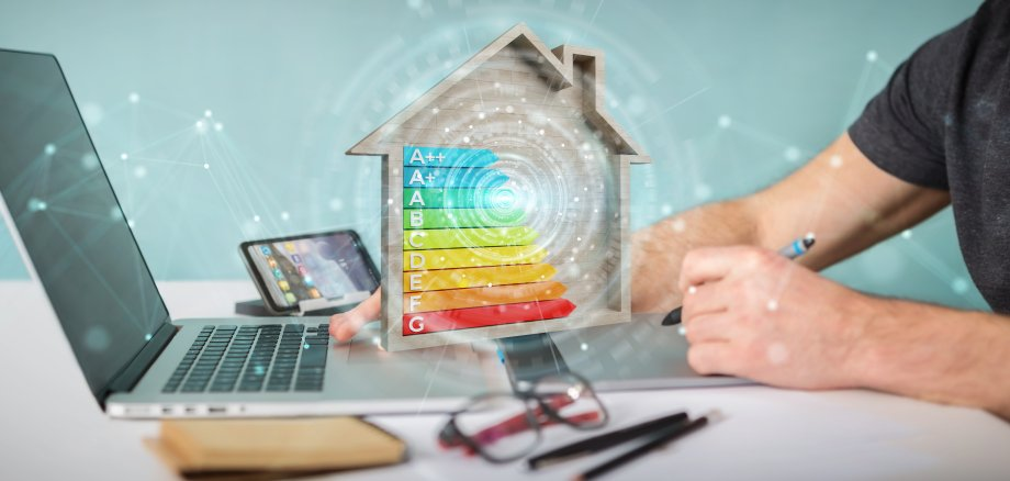 Graphic designer using 3D rendering energy rating chart in a wooden house